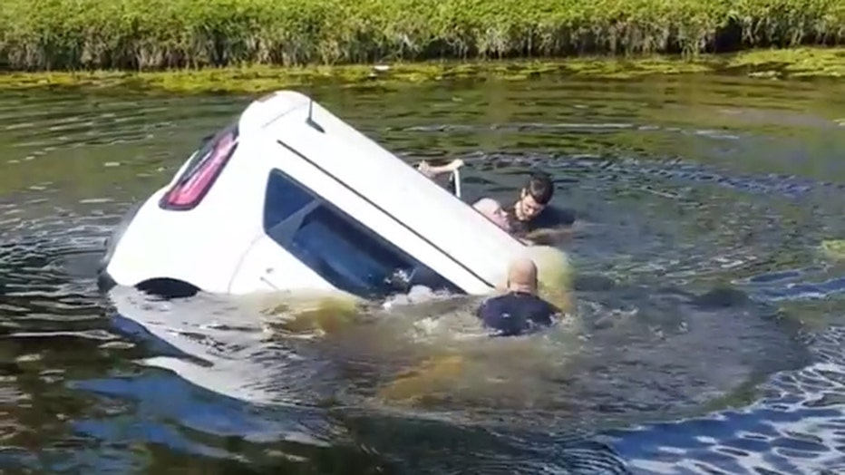 Storyful-232063-Bystanders_Rush_to_Save_Motorist_Who_Drove_Into_Boca_Raton_Canal.mp4_.00_00_49_28.Still002.jpg
