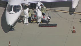 COVID-19 patient arrives at LAX in negative pressure isolation chamber