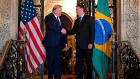 Brazil's President Bolsonaro's son claims father tested negative for coronavirus despite earlier reports