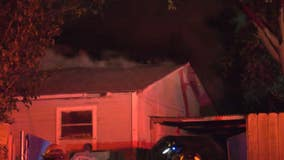 Firefighters rescue man, woman from house fire in the Heights area