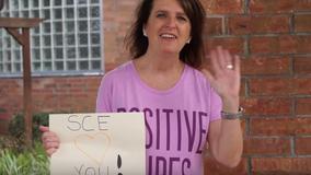 Teachers parade through neighborhood to cheer up their students