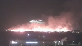 Massive grass fire spreading across east Galveston