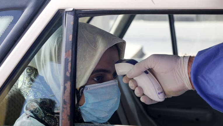 Iran: Death toll from coronavirus climbs to 988