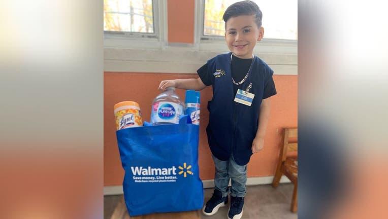 Little boy dresses as Walmart clerk
