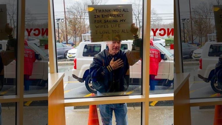 nj_man_holds_sign_thanks_medical_staff_for_saving_wife-credit_allison_swendsen-atlantic_health_system
