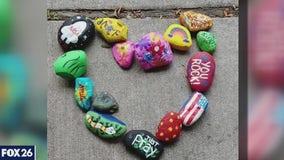 Family paints rocks for senior citizens