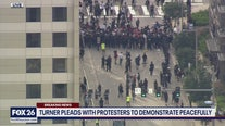 Protesters in skirmish with police during march in downtown Houston