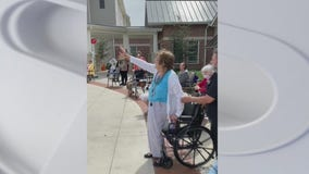 Families drive by retirement community to with loved ones a happy Mother's Day