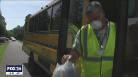 SANTA FE SCHOOL BUS DRIVERS DELIVER MEALS