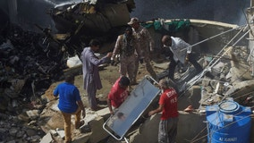 Pakistan jet with 98 aboard crashes in crowded neighborhood