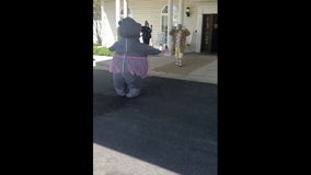 Woman wears sanitized inflatable hippo costume to hug mom living in retirement home