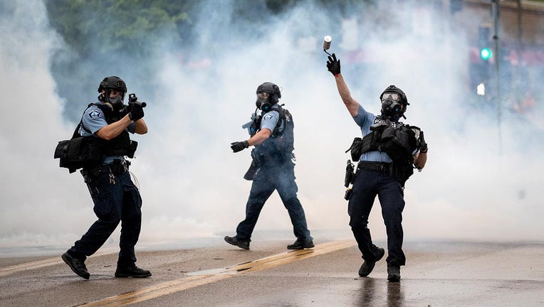 Protesters, officers clash at Minneapolis Police precinct after ...