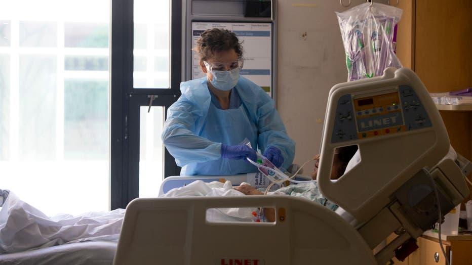 8d52feeb-Health Care Professionals Treat Coronavirus Patients On The Acute Care Floor Of Harborview Medical Center