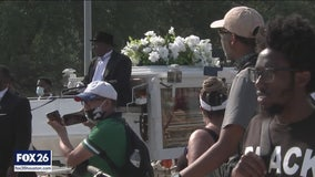 Hundreds line the street to see George Floyd's last mile to final resting place