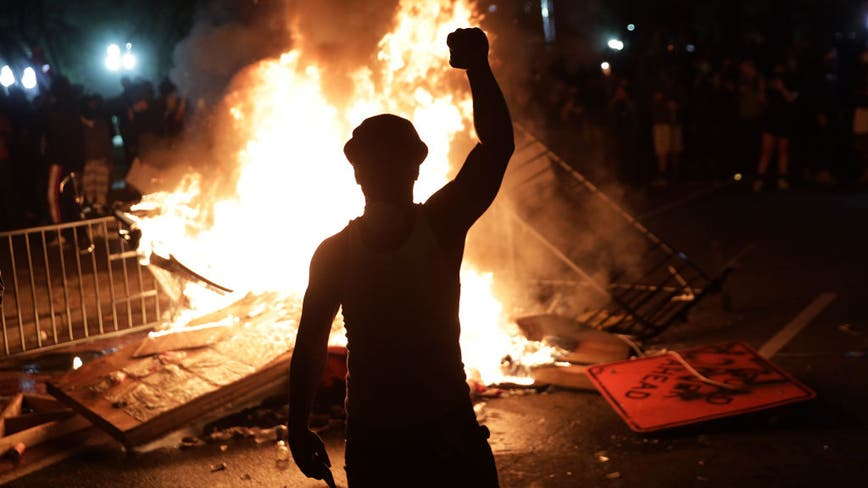 Violence-stricken US cities clean up, brace for more unrest