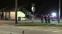Man hospitalized after car crashes into Houston building