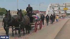 Body of civil rights leader John Lewis crosses Selma's Edmund Pettus Bridge for the final time