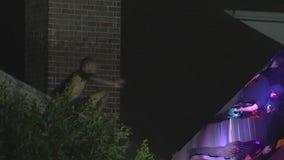 Man found stuck on top of roof during burglary call in Houston, taken into custody