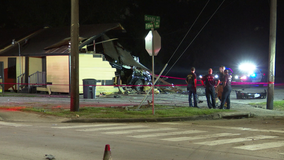 Man hospitalized after car crashes into Houston building