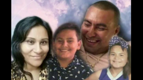 Family of 4 killed, 2 children survive crash with semi