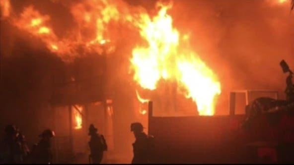 Woman taken into custody after Galveston house fire