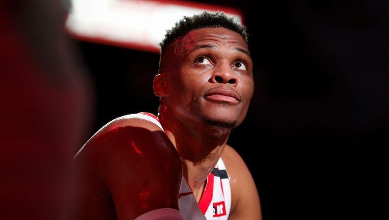 HOUSTON, TEXAS - MARCH 08: Russell Westbrook #0 of the Houston Rockets reacts on the bench in the first half against the Orlando Magic at Toyota Center on March 08, 2020 in Houston, Texas.