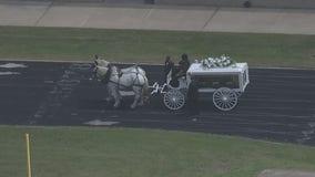 Horse-drawn carriage carries Spc. Vanessa Guillen's casket
