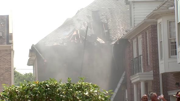 Firefighter taken to hospital following 3-alarm townhome fire in West Houston