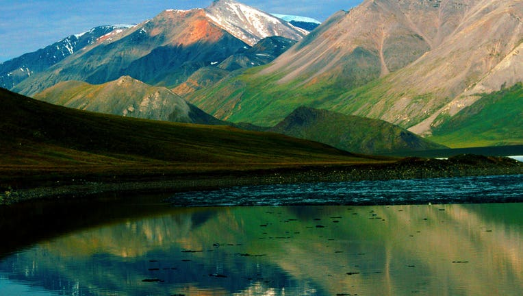 Alaska, ANWR, Franklin Mountains, Brooks Range reflected in Schrader Lake