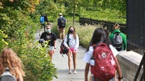 COVID-19 infection rates soar in college towns as students return