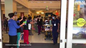 Hospital staff cheers as 13-year-old COVID-19 survivor is discharged after 57 days in ICU