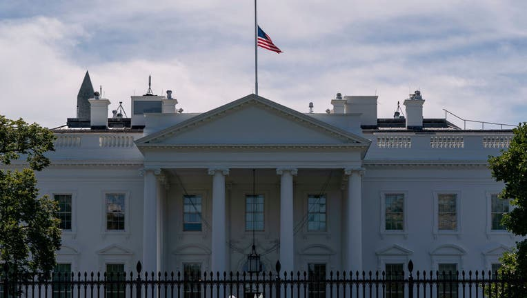 FILE - The US flag flies at half-mast above the White House in Washington, DC, on September 19, 2020 after the passing of US Supreme Court Justice Ruth Bader Ginsburg. - Ginsburg died September 18, 2020.