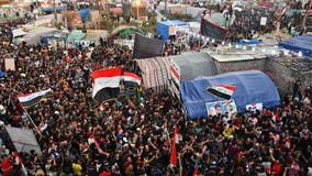 Tear gas fired as thousands mark 1 year of Iraq anti-government protests
