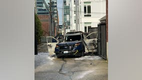 Man arrested after Seattle Police car set on fire with officer inside