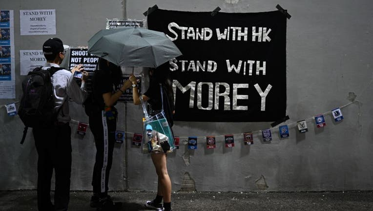 Protesters display posters at the Southorn Playground in Hong Kong on October 15, 2019, during a rally in support of NBA basketball Rockets general manager Daryl Morey and against comments made by Lakers superstar LeBron James. James sharply criticized Morey for angering China with a tweet supporting protesters in Hong Kong, saying the executive was