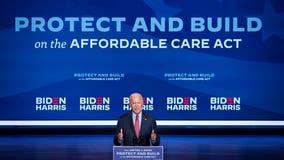 Biden fights to confront crises, Trump resistance