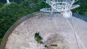 Puerto Rico's iconic Arecibo radio telescope to close in blow to science