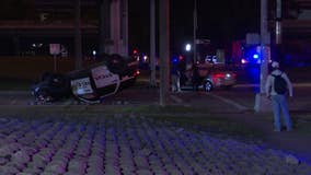 HPD: Officer's patrol vehicle flipped in crash with car that ran red light
