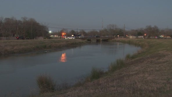 Woman charged with murder after body, car recovered from Harris County canal