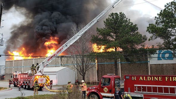 HFD battles large fire at warehouse on SH 249