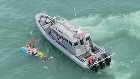 Kids found clinging to paddleboard over a mile off Florida coast