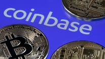 Coinbase stock jumps in Nasdaq debut