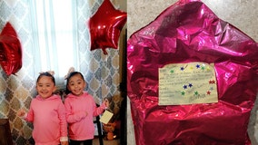 Stranger surprises twins with gifts, a puppy after wish-list balloon to Santa found 650 miles away