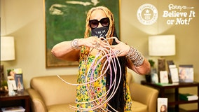 Woman with world's longest nails cuts them after 30 years