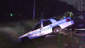 Heavy rain causes Houston police officer to crash while responding to call
