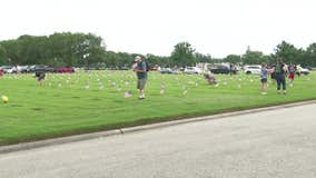 Residents place flags for fallen veterans on Memorial Day