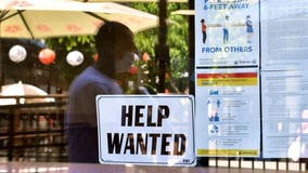US unemployment claims drop to 385,000, another pandemic low