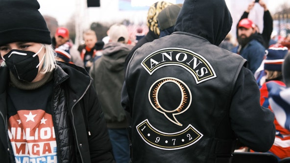 QAnon believers could engage in 'real-world violence,' FBI warns