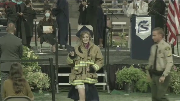 Daughter of firefighter killed in shooting wears father's jacket to graduation