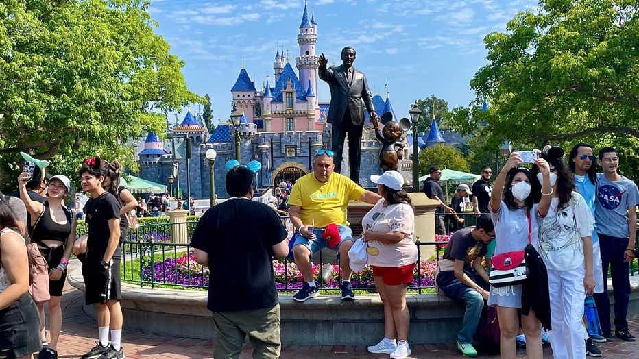 Disneyland walt disney statue snow white castle covid